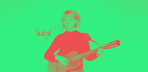 Woman playing guitar duotoned, the background is green and she is red
